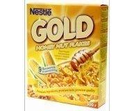 Завтрак Nestle Gold Flakes сухой мед-орех 500г